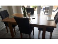 SOLID OAK DINING TABLE WITH 4 CHAIRS.