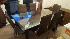 *REDUCED PRICE* Glass top dining table and 6 Brown chairs