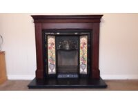 Mahogany fireplace surround with cast iron inset....fire never lit so all as new.