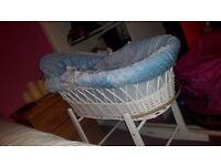 Blue and white moses basket