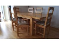 Immaculate solid block pine dining table with 6 matching chairs.