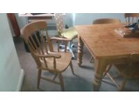 Very solid antique pine wooden table and 6 chairs