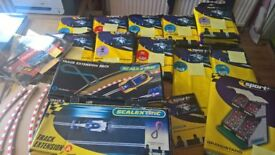 Job lot Scalectrix packs for sale - 14 packs plus extras, mainly unopened.