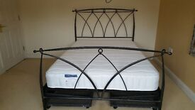 """4' 6"""" Metal frame bed with brand new mattress"""