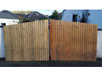 Unused pair of redwood timber gates, 12 ft wide, 5ft 6 at highest point, with posts and ironmongery