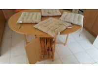 Folding drop leaf table with 4 folding chairs