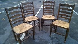 4 solid oak ladder back chairs with original seating