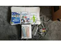 Wii, Wii fit board, 3 games and 2 controllers
