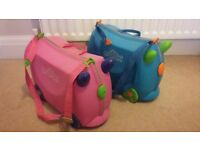 Trunki cases, blue and pink. £10 each.