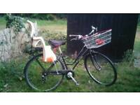 Ladies bike with child seat and with lock in good condition..