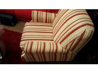 Red and cream striped manual reclining chair