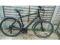 Hybrid bike carrera crossfire cheap