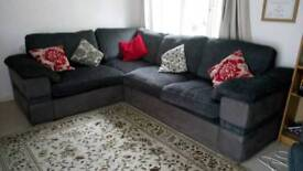 Grey corner couch and cuddler swivel chairs