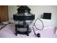 Halogen, multi purpose stand alone cooker with timer.