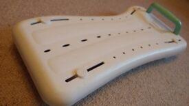 Adjustable bath board for seated washing