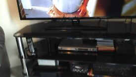 black glass chrome tv stand,robust, heavy but really chic for sale