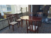 Extendable dinning table with 6 matching chairs
