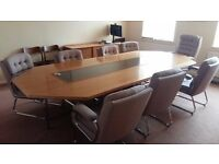 Boardroom table and 8 upholstered chairs.