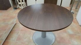 "Round Large Brown Table. Height 28.5"" x Width 39.5"""