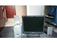"17"" computer monitor with speakers and a booster for sale."