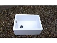 White Butler Sink Hardly Used. was new in kitchen but replaced when moved here.