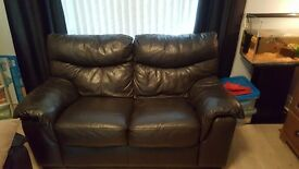 Brown 2 Seater leather sofa and foot rest for sale.
