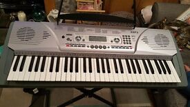 AXUS ELECTRONIC KEYBOARD AND STAND MINT CONDITION