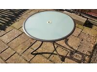 Garden table with clouded glass on the underside