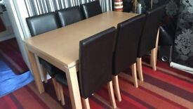 6 FAUX LEATHER CHAIRS AND OAK DINNING TABLE