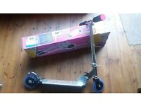 Childs metal light up scooter, nearly new in box