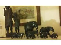 Carved Sudanese tribesmen and elephants
