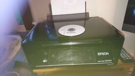 Epson wireless printer with installation Cd and ink cartridges