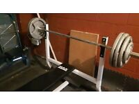 Bench press bench with 6ft olympic bar with 120kg discs.