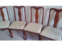 4 wooden chairs with material inserts