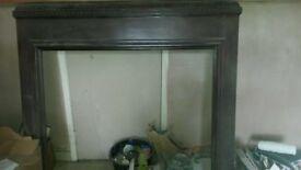 Dark wood fireplace surround