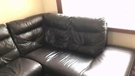 Large brown leather corner unit and chair