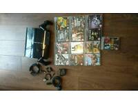 Ps3 with 2 pads, headset and 13 games