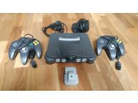 Nintendo 64 with two (2) controllers and one (1) rumble pak