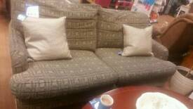 Wesley Barrell navy and gold sofa