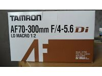 Nikon fit,-Tamron 70-300 mm lens with close focus function.