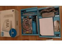 Nintendo WIi + 8 Games + wii fit platfort with wii fit and wii fit plus CDs