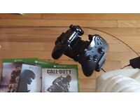 Xbox one with 2 controllers, docking station and 5 games excellent condition