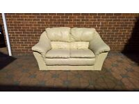 Pair of cream leather 2 seater sofas in great condition