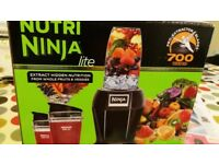 Nutri Ninja fruit & vegetable juicer in nearly new condition comete with all the extras 700wtts, etc