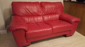 Modern red leather 2 seater sofa and armchair -excellent condition £120