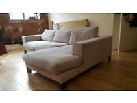 Large L-Shaped Sofa. Very Comfortable. Light grey colour. Seats 5 - 6 people.