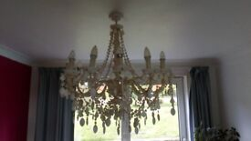Faux ivory twelve candle chandelier (with led candle lamps) quite swanky.