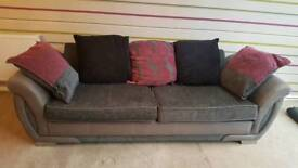 Large dark grey sofa and love seat/swivel chair DFS