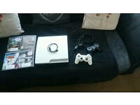 PlayStation 3 in white with games