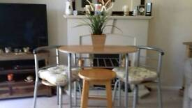 Dining table and slide away chairs and stool
